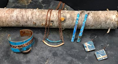 Wearable art created in Montana using recycled copper, metals & found wood.