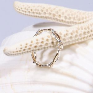 """""""Where the ocean meets the shore... White foaming surf, represented by Sterling Silver, engulfs the sandy beach, symbolized by the 14K Gold-Fill band. Each piece is handcrafted in the USA."""""""